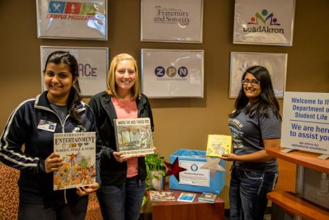 Book Drive: Sarah Dhinojwala-Junior on the right Yamini Yamini-Junior on the left Ally Vidika- Senior in the middle
