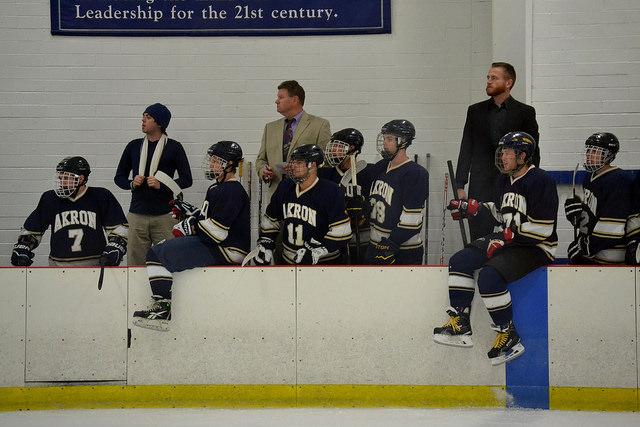 The Zips bench checks out the action on the ice.