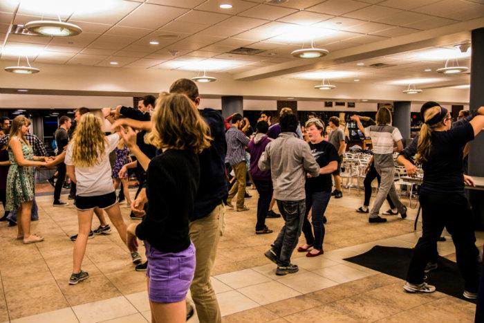 Ballroom Dance Club teaches students how to swing dance step-by-step.