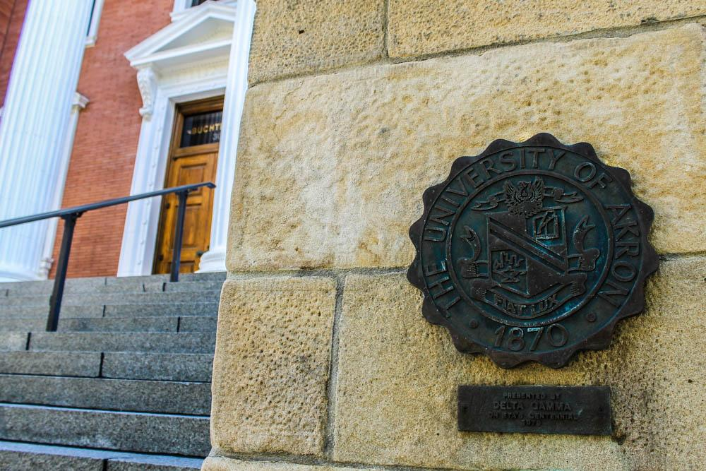 Seal of The University of Akron in front of Buchtel Hall.