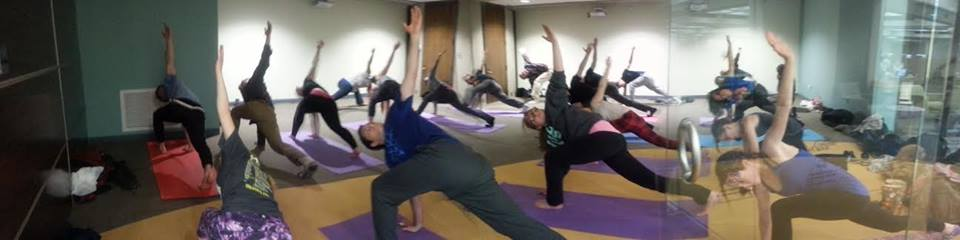 Syed teaches students yoga in Bierce Library.
