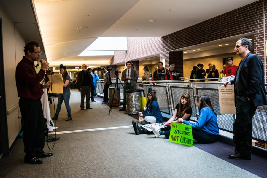 Protesters+in+the+hallway+on+the+third+floor+of+the+Student+Union%2C+where+the+Board+meeting+was+held.+