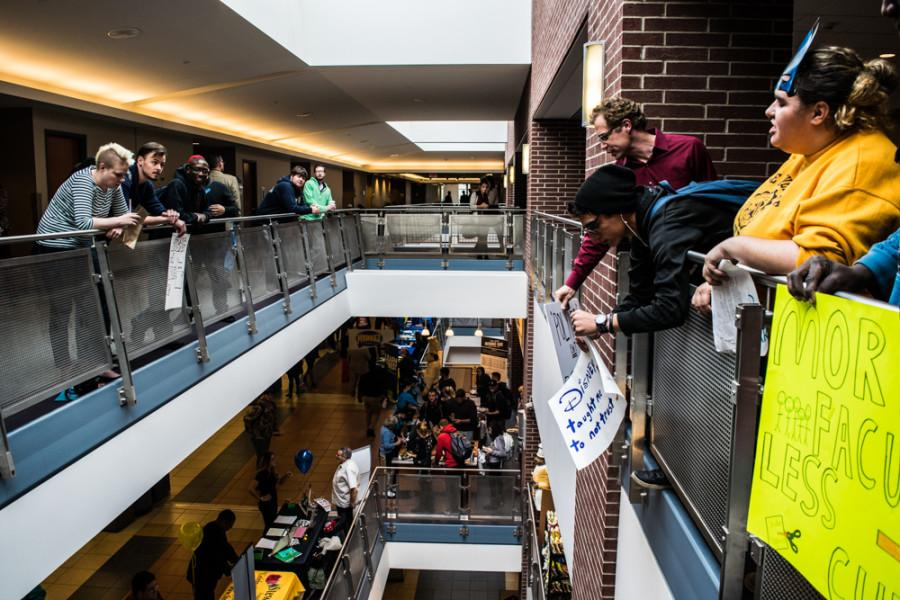 Protesters+attempt+to+attract+attention+of+people+on+second+floor+of+the+Student+Union.