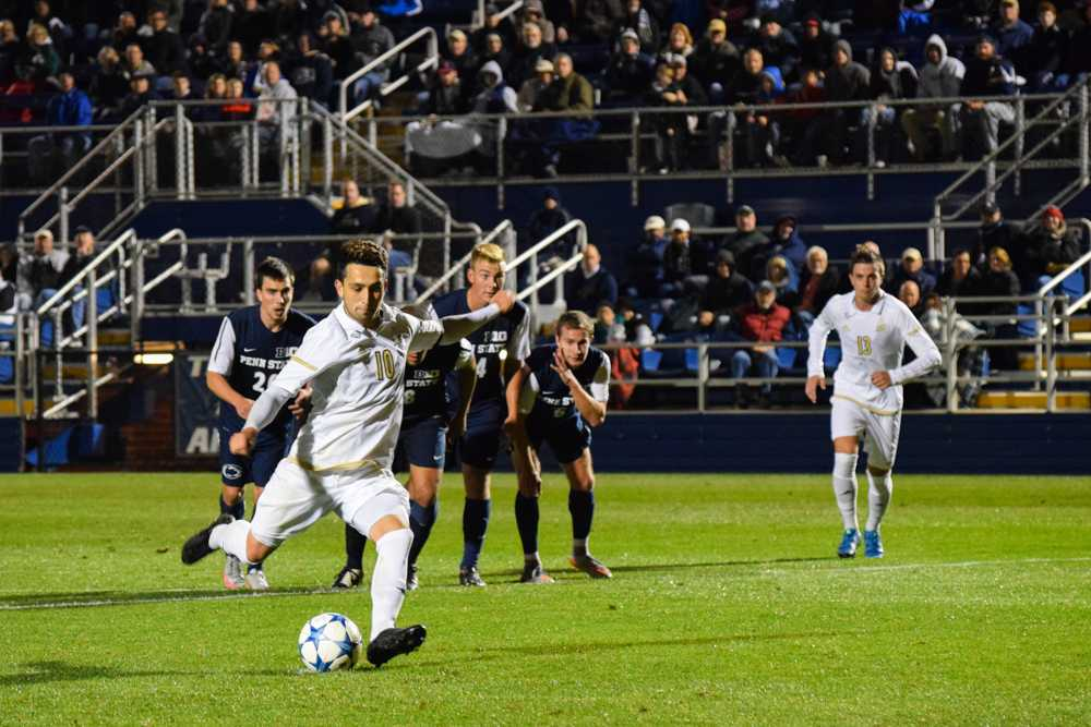 Adam Najem scores a goal during a penalty kick in 2nd half against Penn St.