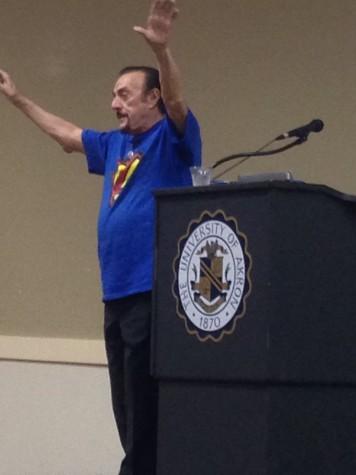 Dr. Zimbado addresses 1100 audience members at Quaker Station Monday night.