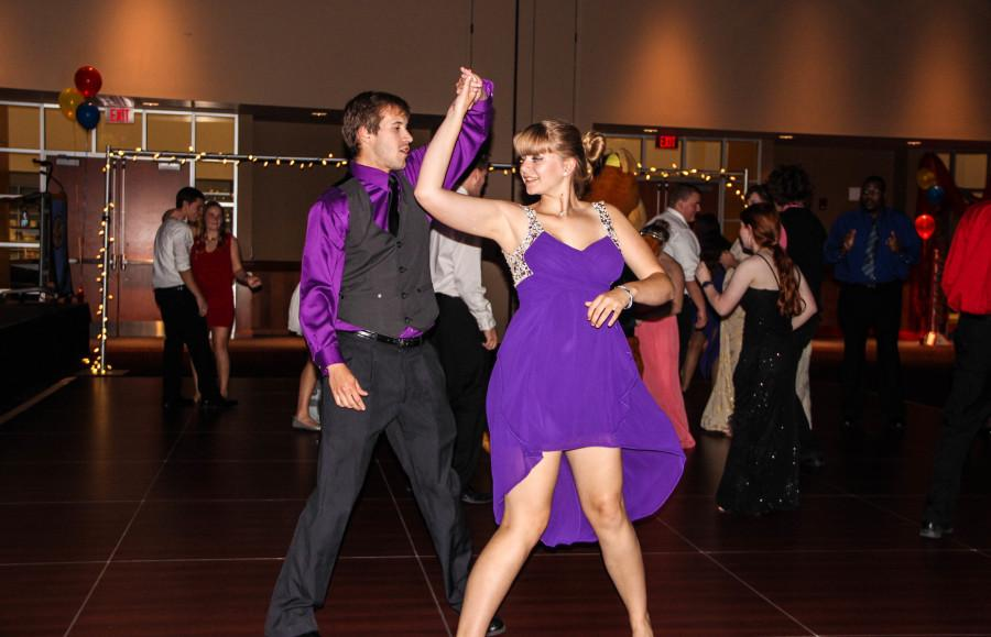 Patrick Keenan and Shianne Cunningham dance together amongst other students on the dance floor.