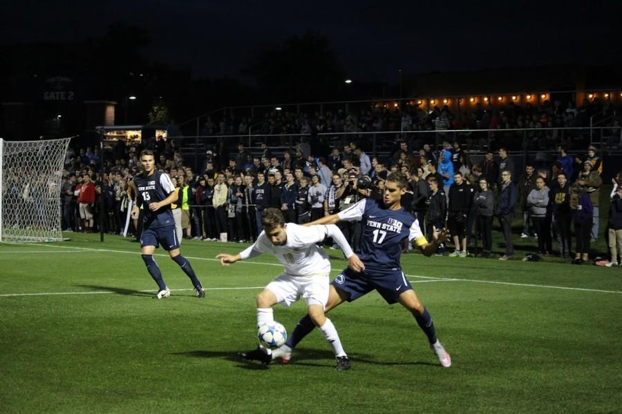 Adam Najem battles against a Penn St. defender