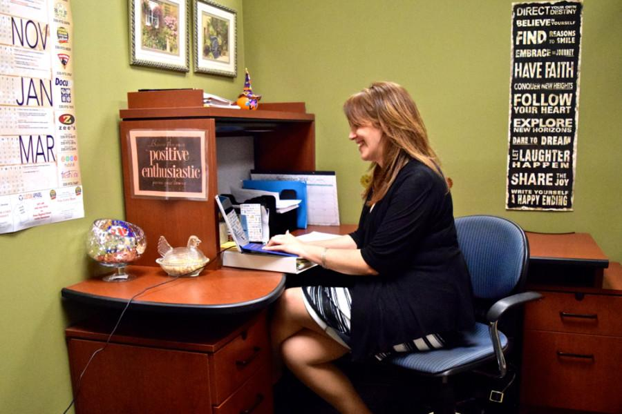 Lauren Walter, a student success coach, works in her office in Simmons Hall.