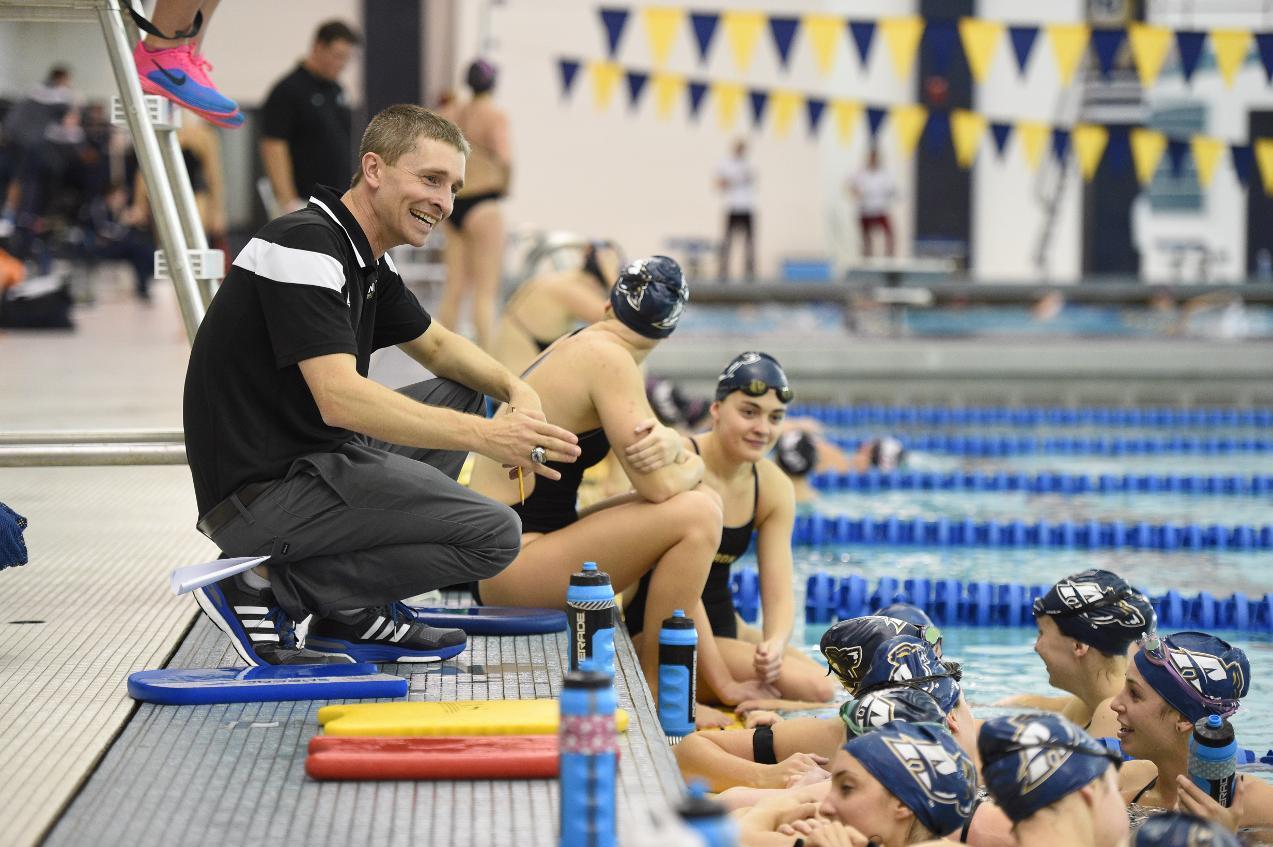 Coach Brian Peresie talks with his team