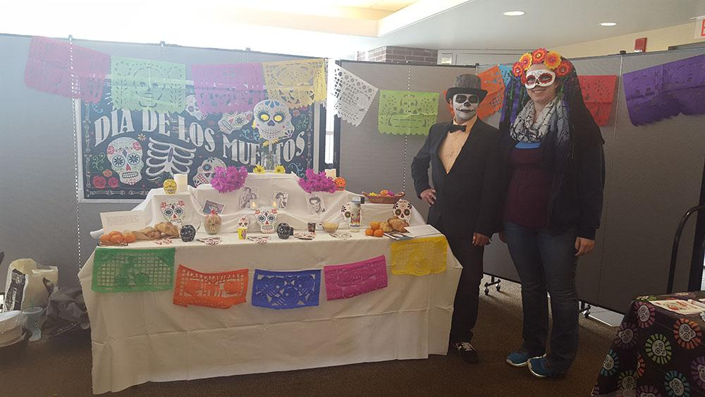 Megan Grund and Alvaro Rodriguez, H.O.L.A. members, dress in traditional costumes to celebrate Day of the Dead.