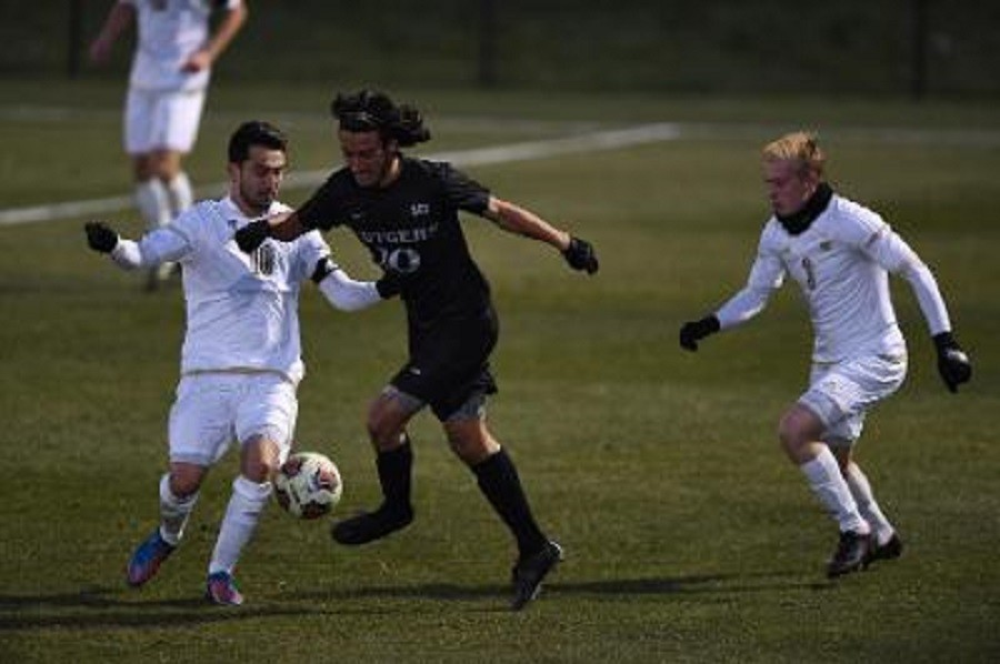 Adam Najem (10) battles for the ball as Sean Sepe (3) looks on