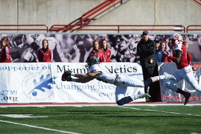 Austin Wolf dives for the Thomas Woodson pass against the RedHawks.