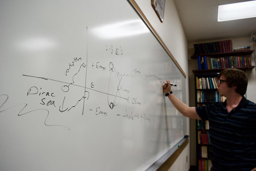 Gantzler tutors fellow physics students in Ayer Hall.