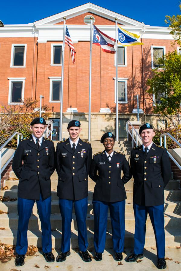 Left to right: William Lairson, Brian Bursley, Charleza Gourdon, and Zachary Gould.The senior student leaders of UA's ROTC program stand in front of Buchtel Hall following the Veteran's Day ceremony.