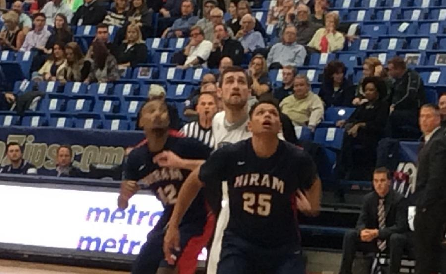Pat Forsythe (middle) battles two Hiram defenders for the ball.