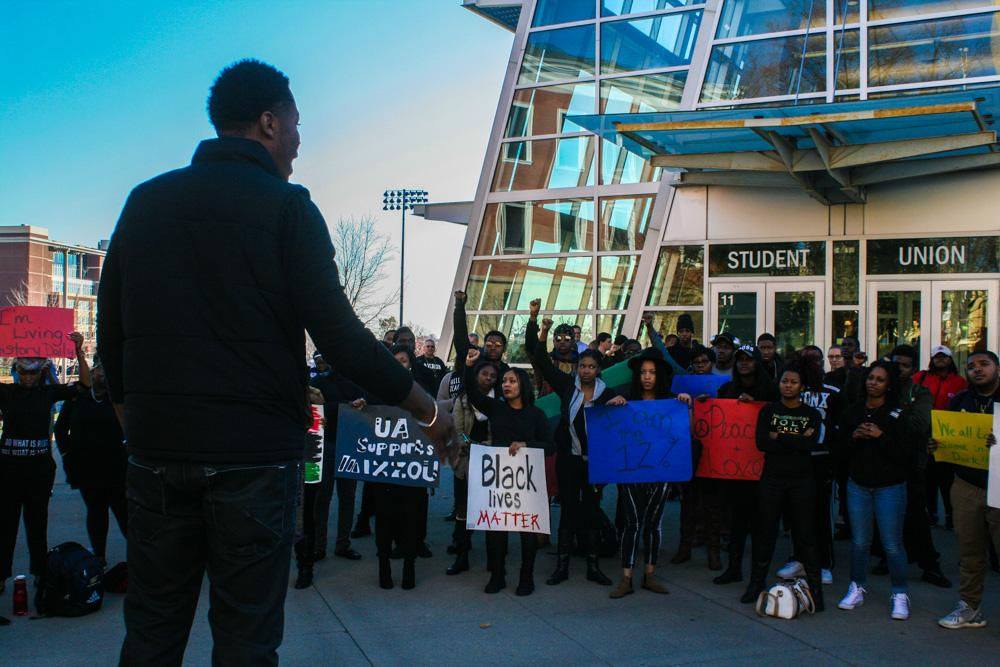 UA senior Eric Leak gives a speech in front of the Student Union.