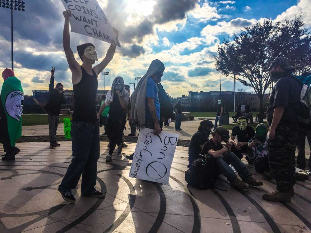 Anonymous protesters gather at the Coleman Commons.