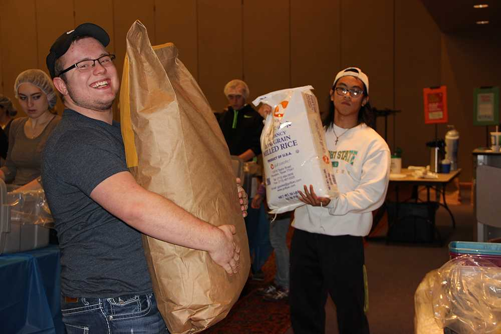 Volunteers package meals for the homeless