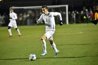 Stuart Holthusen (9) leads Akron to victory over West Virginia with two goals.