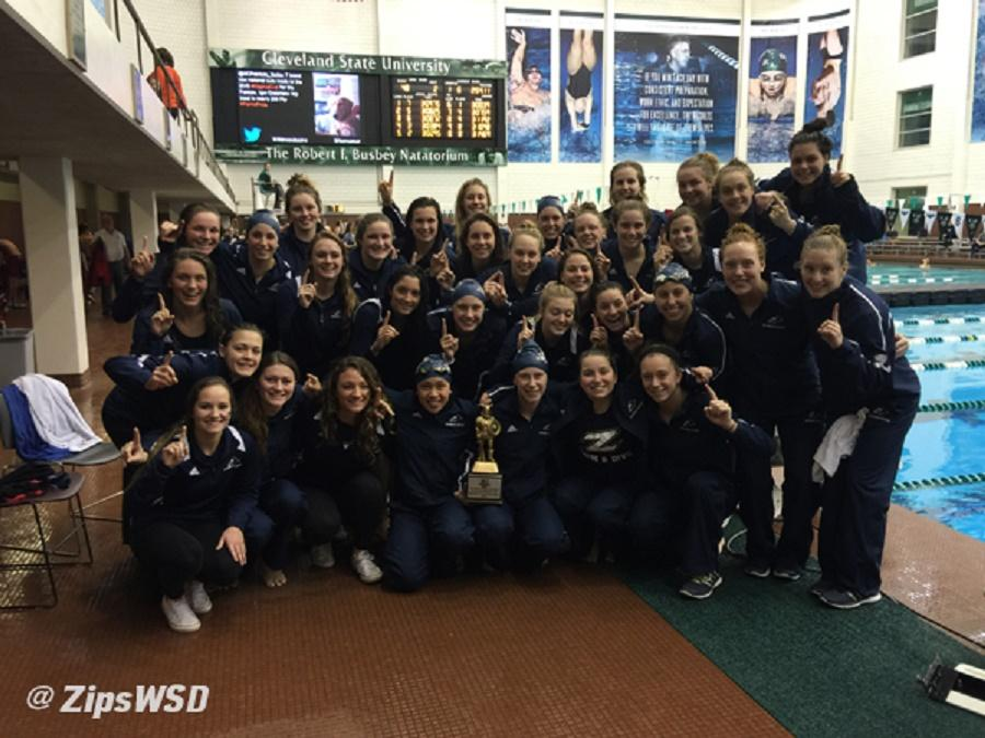 The University of Akron swimming and diving team celebrates the winning of the Magnus Cup