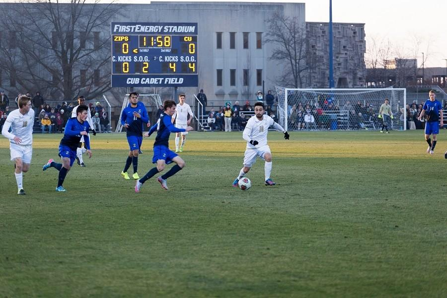 Adam Najem (10) tries to get the ball back for the ZIps offense.