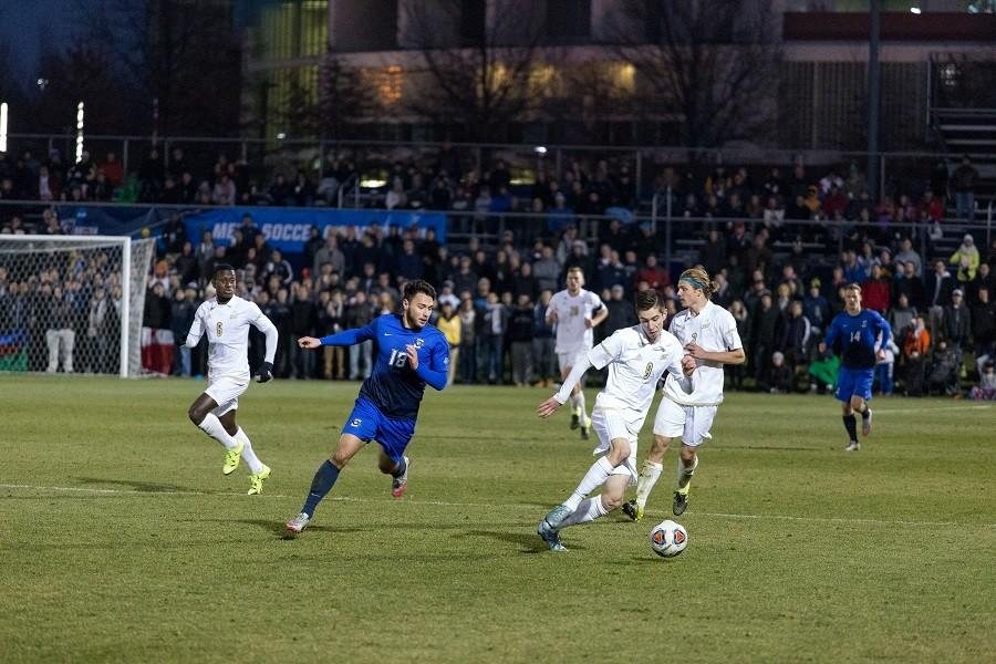 Stuart Holthusen (9) keeps the ball away from the Creighton player.