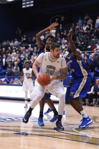 Men's hoop hangs on against Coppin State