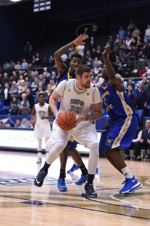 Pat Forsythe (35) working to get 2 of his game high 20 points against Coppin State.