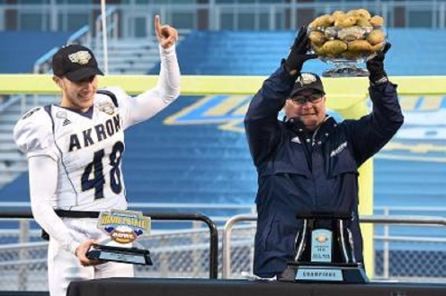Robert Stein (48) and head coach Terry Bowden celebrate the Zips win
