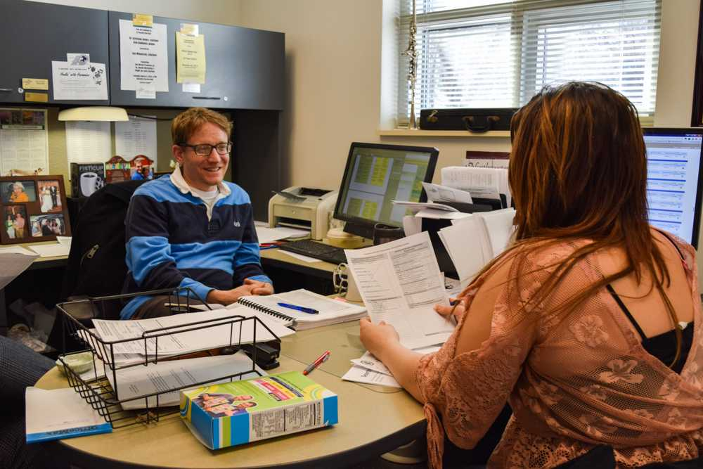 Joe Minocchi, an academic advisor in the College of Arts and Sciences, speaks with a student about scheduling classes.