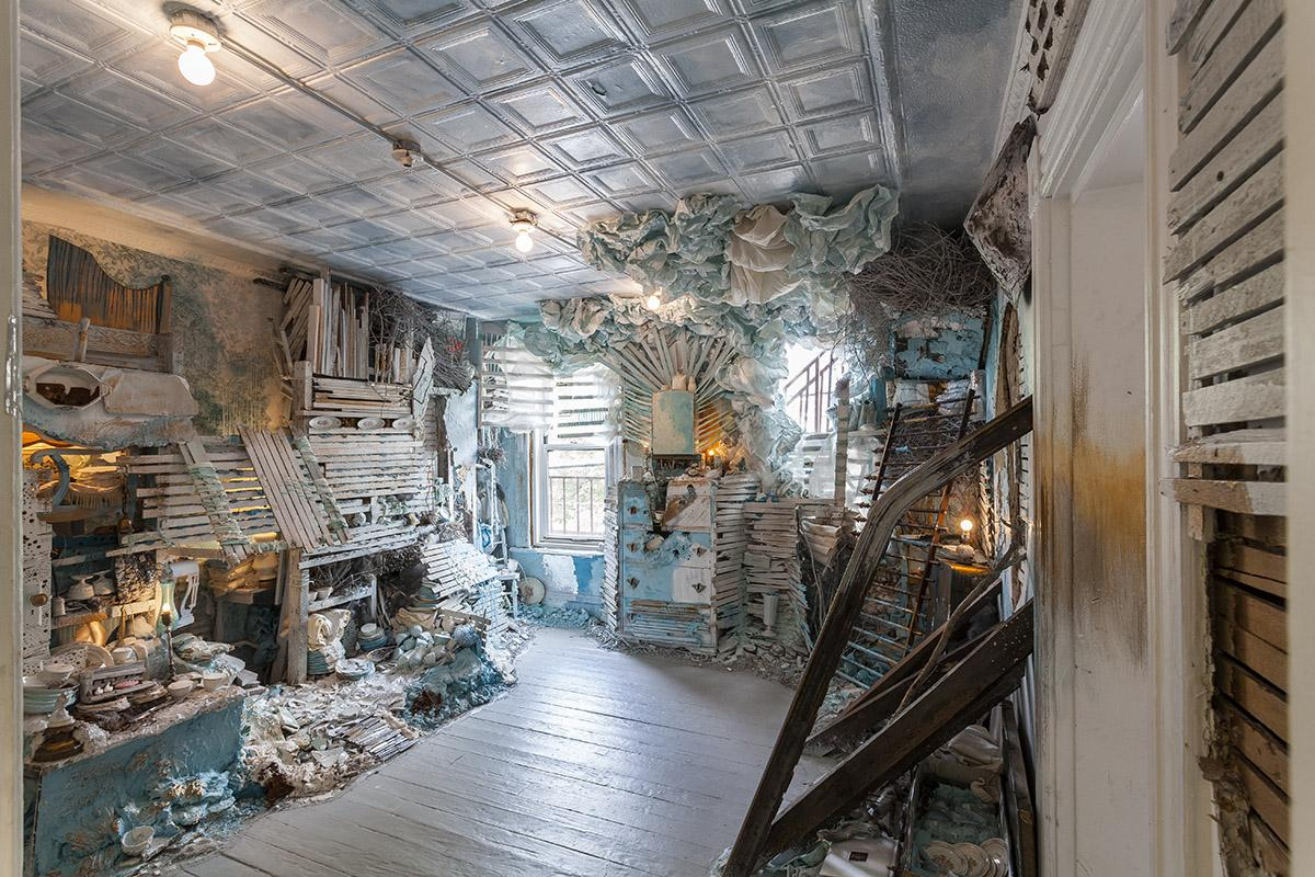 The artist's work features full-room installation pieces created from recycled and reclaimed materials.