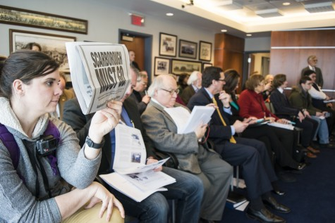 Ashley Bair silently protests by holding up the Akron Beacon Journal