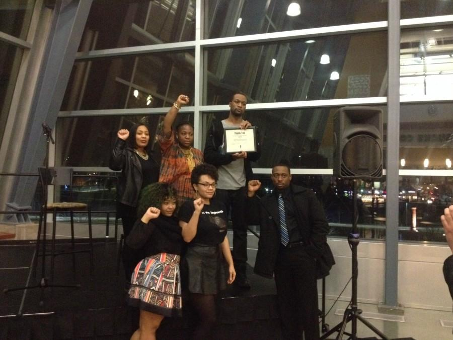 Members+of+Black+Students+United+presented+%22Too+Black%22+with+a+thank-you+plaque+following+his+show.