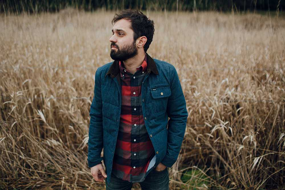 Singer-songwriter Mike Edel promotes his recent album