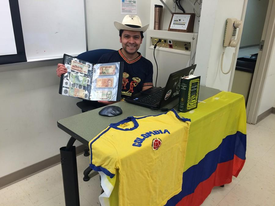UA student Alvaro Rodriguez shows Colombian currency.