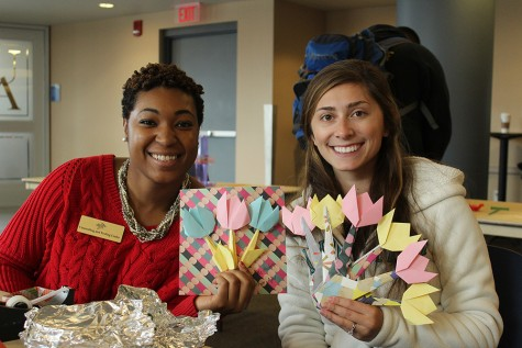 Graduate students, April Barnes (left) and Sharon Schwam (right) showing off their origami tulips.