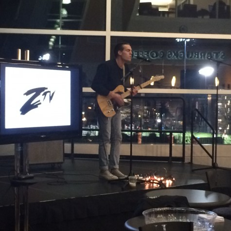 Student Paul Clifford performs songs while playing guitar in the Starbucks Lounge.