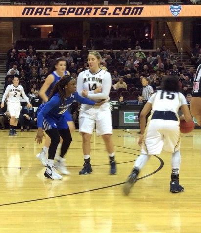 Anita Brown drives around a Greta Burry pick during the MAC Tournament game against Buffalo.