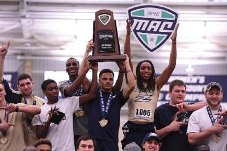 Some of the members of the men's track team celebrate the third straight MAC title.