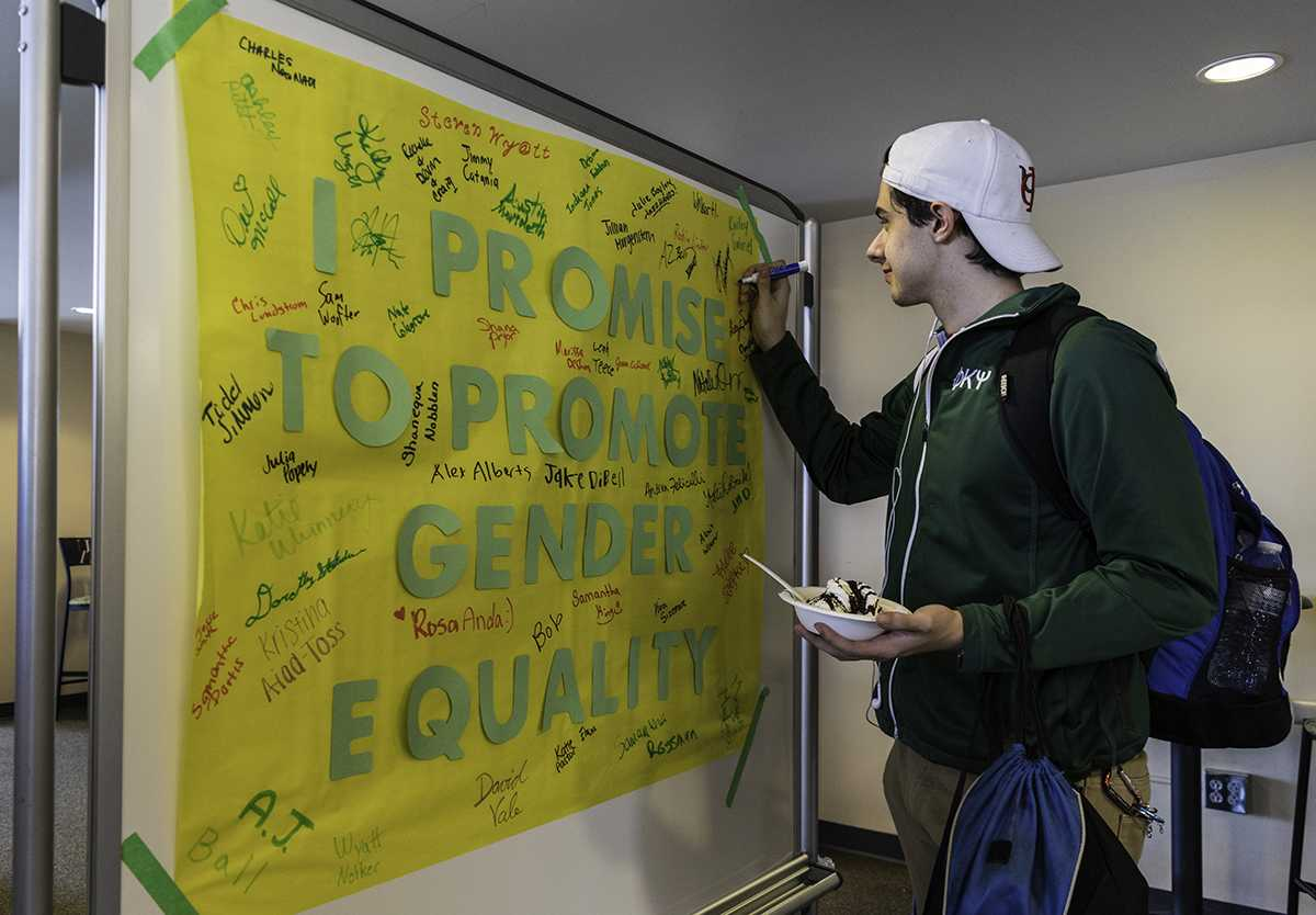 Students sign the gender equality promise during ZPN's event for Gender Diversity Week.