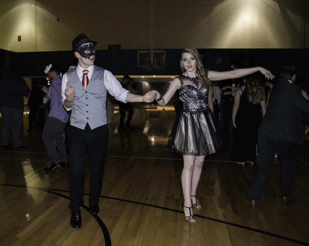 Erika Nosal and Louis Orehek, both mechanical engineering students and ballroom competition team members, performed traditional ballroom dances.