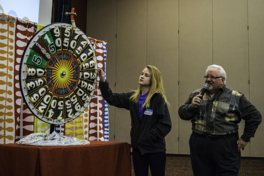 Anna Cartwright spins the wheel to win the first showcase round at the Price is Right event in the Student Union Ballrooms.