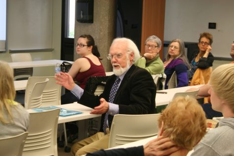 Shakespeare scholar and former UA professor William Williams enlightens the audience on the playwright's folios during the first presentation of Friday afternoon.