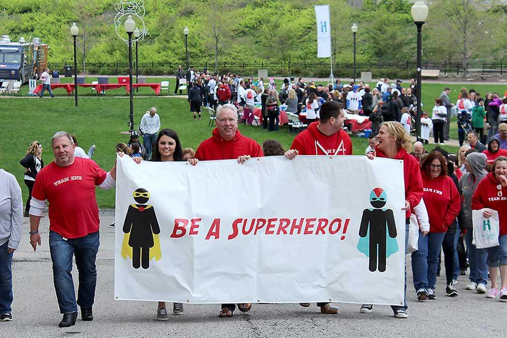 Participants walk for sexual assault awareness.