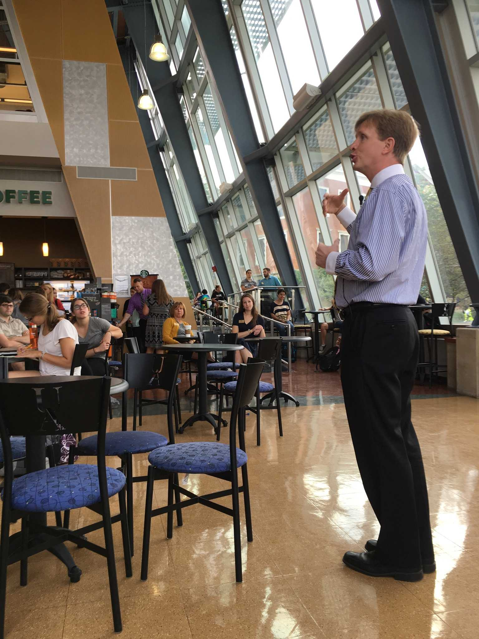 Interim President Wilson talks to students during the Town Hall meeting at Starbucks on Sept. 7.