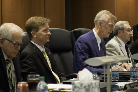 President Matthew Wilson (left) sits next to Board Chair Roland Bauer (right).