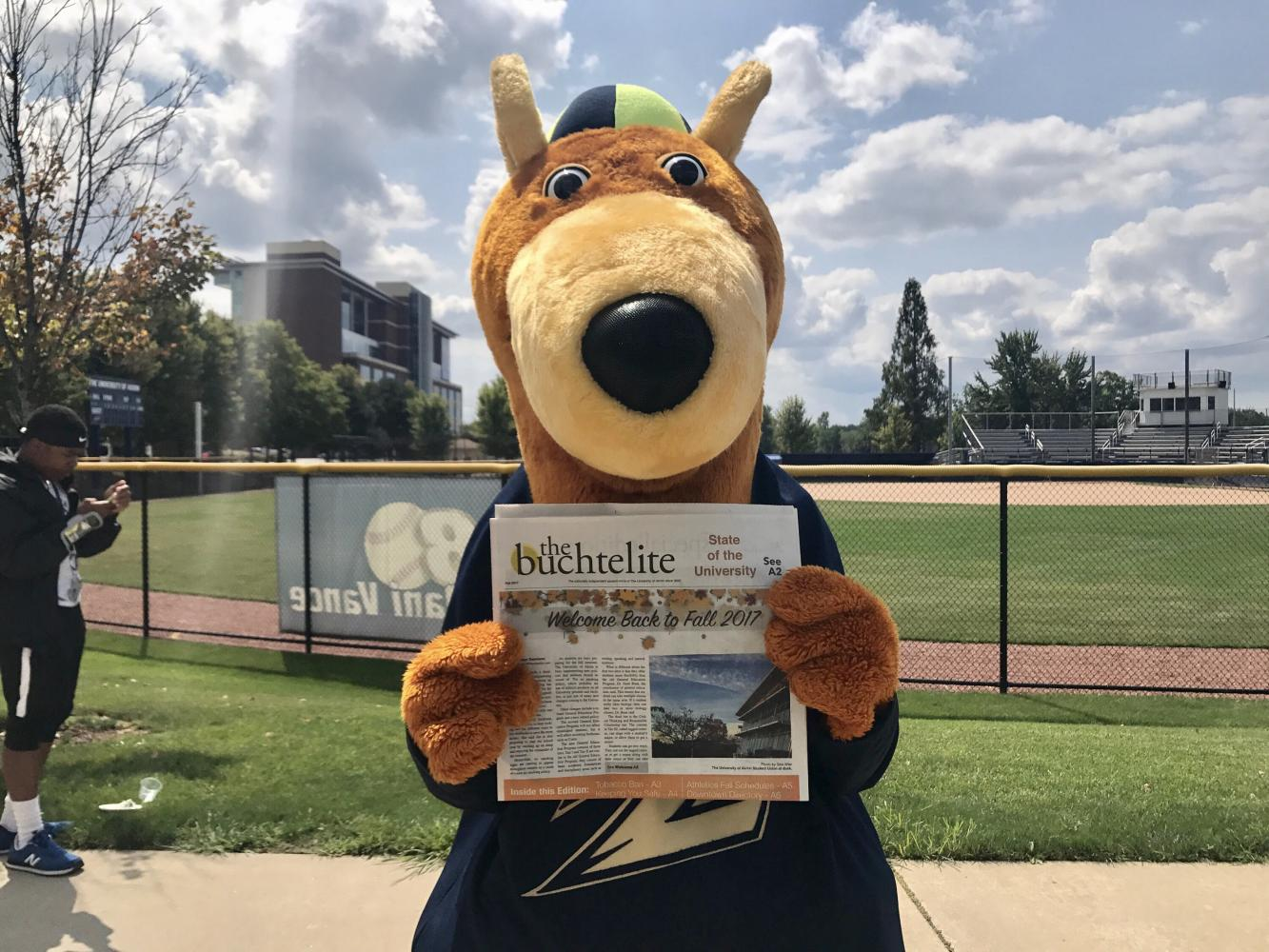 Zippy, the official UA mascot, holds a copy of The Buchtelite.