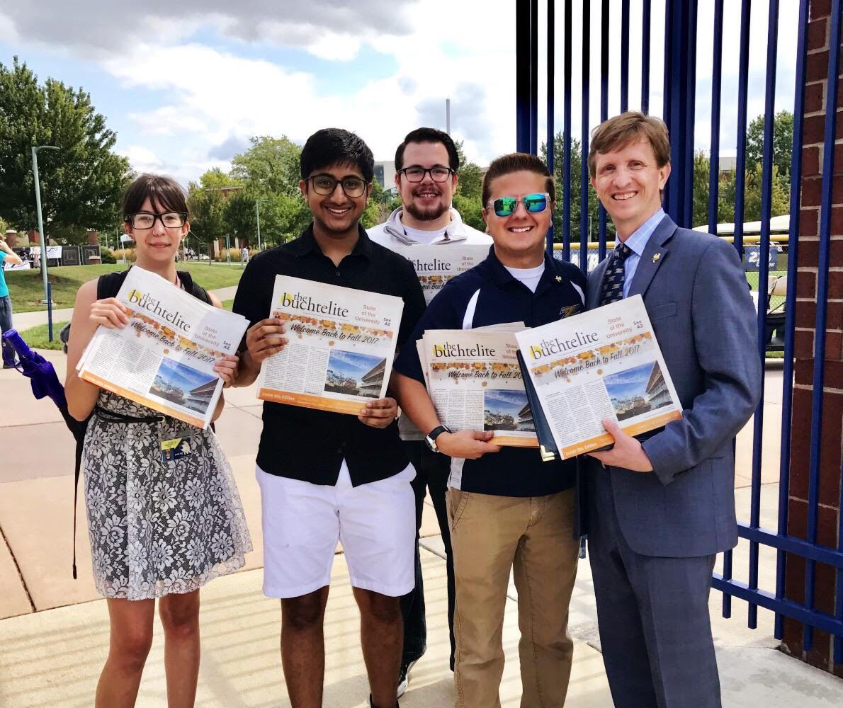 Members of The Buchtelite editorial Staff present UA President Matthew J. Wilson with a copy of the first Special Edition of The Buchtelite.