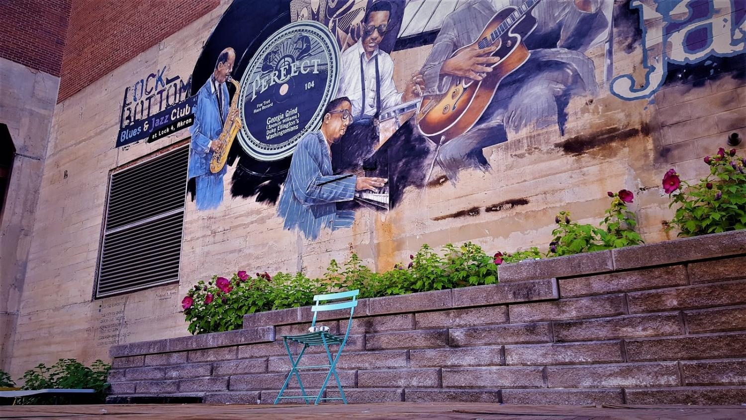 This mural outside the Civic Theater greets visitors   at the canal level of Lock 4 Park.