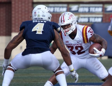 Akron Zips cornerback, Kyron Brown looks to block Iowa State's running back, David Montgomery. (Photo Courtesy of The University of Akron Department of  Athletics)